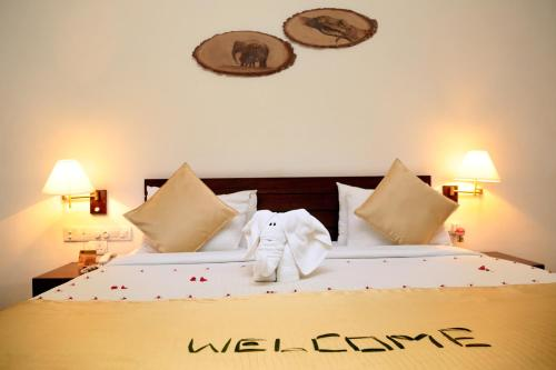 A bed or beds in a room at Grand Udawalawe Safari Resort