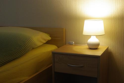 Łóżko lub łóżka w pokoju w obiekcie Zajazd Biały Dom