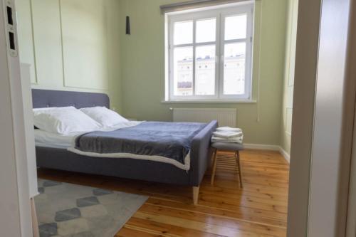 Łóżko lub łóżka w pokoju w obiekcie Stylowy Apartament Art-Deco Głogowska