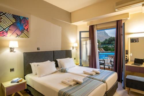 Ένα ή περισσότερα κρεβάτια σε δωμάτιο στο Kleanthi Apartments