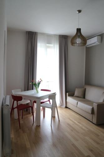 Area soggiorno di Musmelia Rooms - Affittacamere