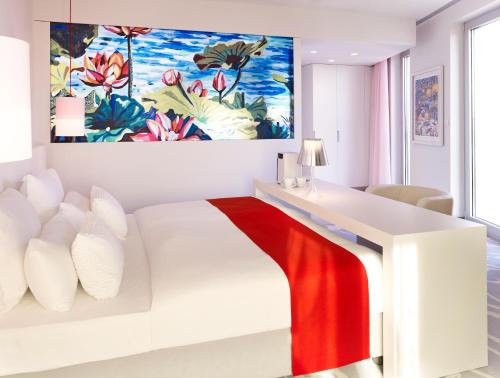 A bed or beds in a room at art'otel cologne by park plaza