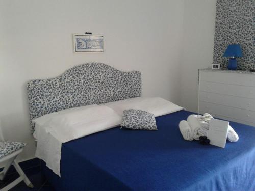 Letto o letti in una camera di Casa Blu Cobalto