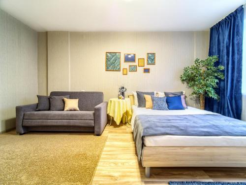 Кровать или кровати в номере KvartalApartments. Karla Marksa 58