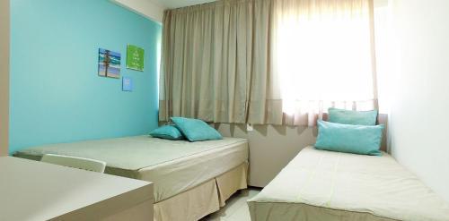 A bed or beds in a room at Excelentes apartamentos Barra Bali