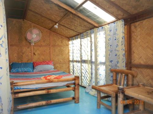 A bed or beds in a room at Coron Backpacker Guesthouse