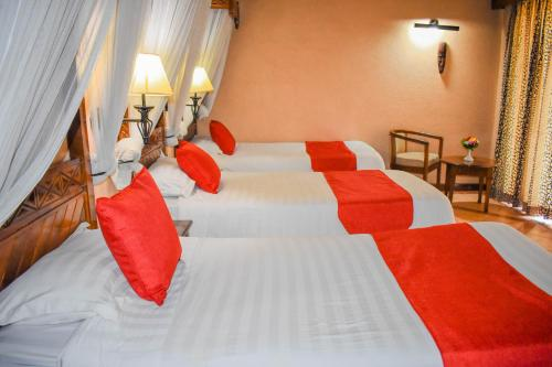A bed or beds in a room at Lake Nakuru Lodge