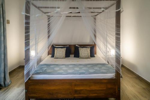 A bed or beds in a room at Madla rooms