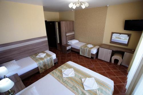 Кровать или кровати в номере Отель Имера All Inclusive