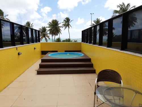 The swimming pool at or near Flat Mar do Cabo Branco Residence