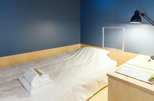 Area Inn Fushimicho Fukuyama Castle Side 2-8にあるベッド