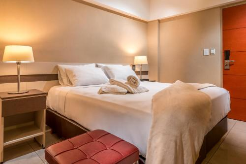 Cama ou camas em um quarto em Up Recoleta Hotel