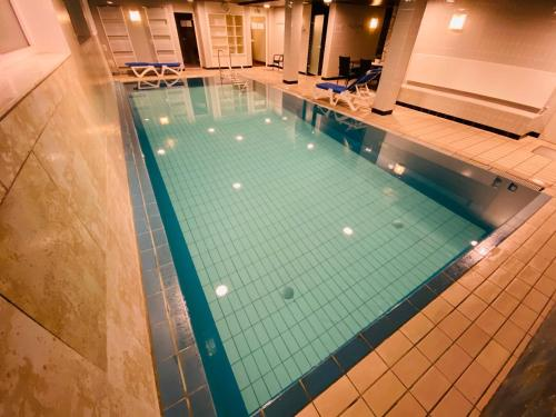 The swimming pool at or close to Hotel Exquisit