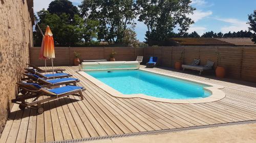The swimming pool at or near Le Gite de la Prunette
