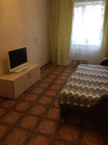 A bed or beds in a room at Апартамент на Красной Сибири