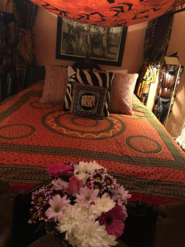 A bed or beds in a room at Belmont House Boutique - the Kingsley collection