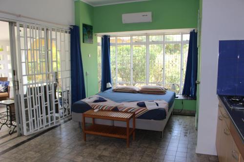 Cama ou camas em um quarto em Annidas Sambuya