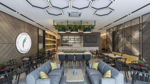 Ο χώρος του lounge ή του μπαρ στο Hotel Papagalos