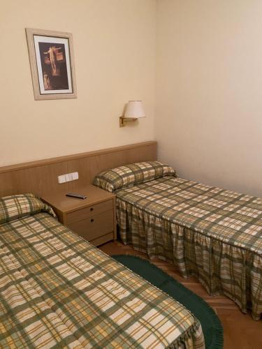 A bed or beds in a room at Mirasierra