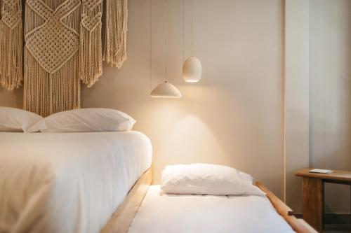 A bed or beds in a room at Casa Pancha