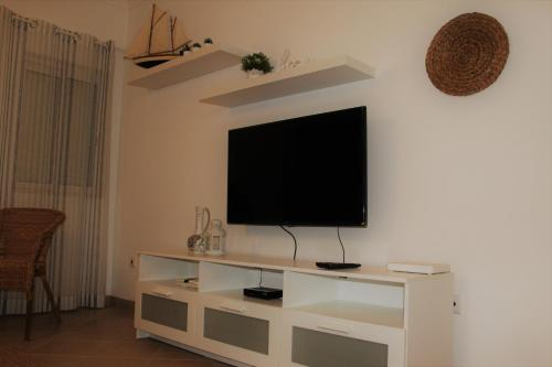 A television and/or entertainment center at Casa Camões, near airport, 4km Faro beach
