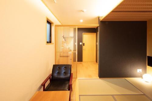 Kamon Inn Toji Michi カモンイン 東寺道にあるテレビまたはエンターテインメントセンター