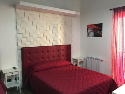 A bed or beds in a room at La Nuova Girgenti