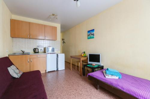 A kitchen or kitchenette at Квартира в новом доме Одоевского 1 10