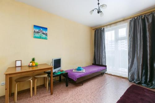 A bed or beds in a room at Квартира в новом доме Одоевского 1 10