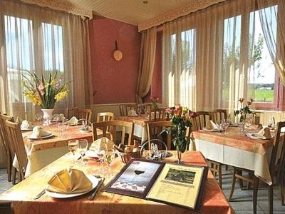 A restaurant or other place to eat at Logis Relais des Monedieres