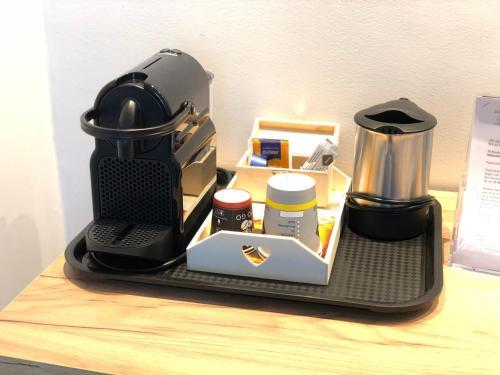 Kaffee-/Teezubehör in der Unterkunft Millrather Brauhaus