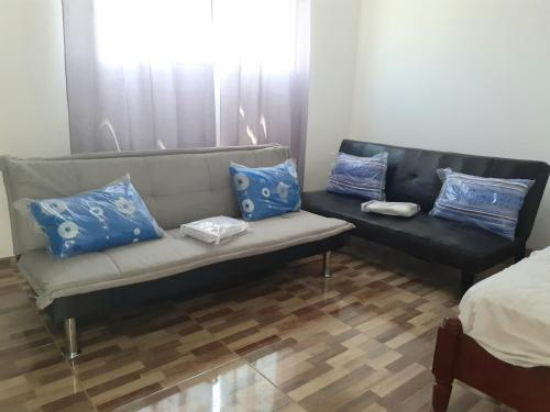 A seating area at CINNAMOM APARTMENT