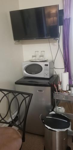 A television and/or entertainment centre at Dominique's Getaway NYC