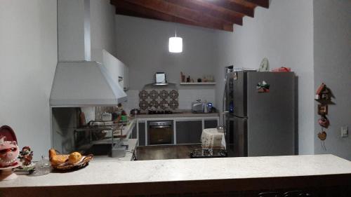 Una cocina o zona de cocina en Casa Aconchegante