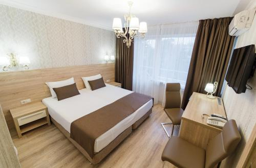 A bed or beds in a room at Nadezhda Health Resort