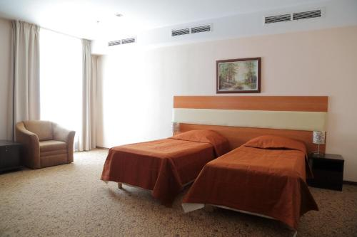 A bed or beds in a room at Mitino Hotel