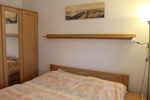 A bed or beds in a room at Apartmán Lipánek