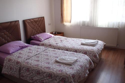 A bed or beds in a room at Emre's Stone House