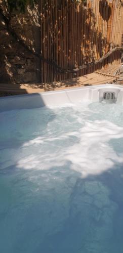 The swimming pool at or near Maison de maître à BRAM # Jacuzzi