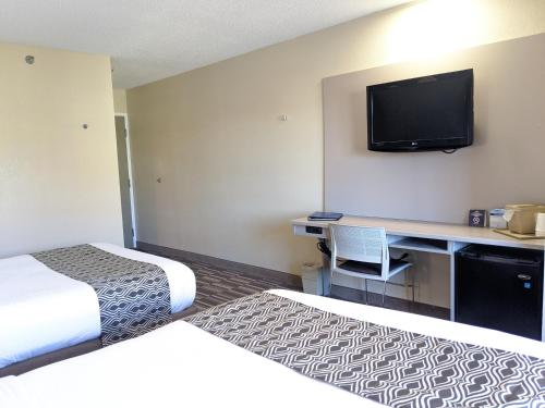 A television and/or entertainment center at Microtel Inn Georgetown - Lexington North