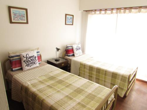Posteľ alebo postele v izbe v ubytovaní Casa Buena Vista Tandil