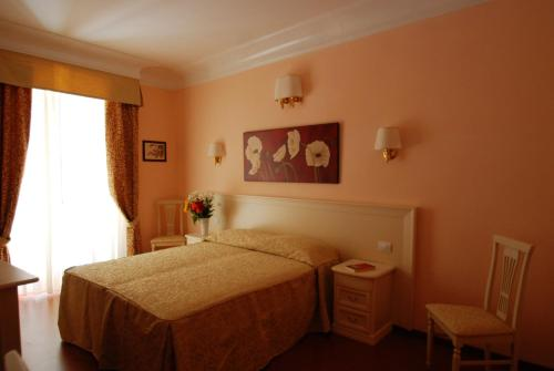 A bed or beds in a room at Adriana e Felice