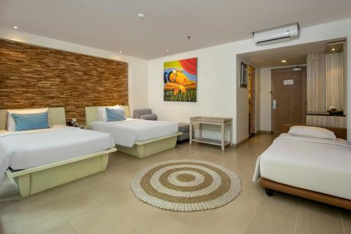 A seating area at Away Bali Legian Camakila Resort