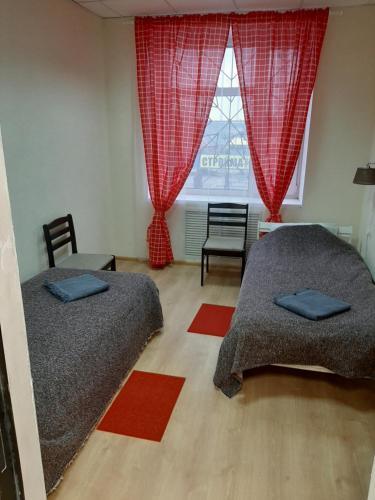 A bed or beds in a room at Hostel Svetofor