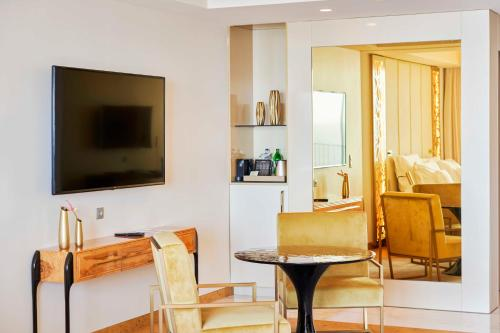 A television and/or entertainment center at Savoy Palace - The Leading Hotels of the World - Savoy Signature