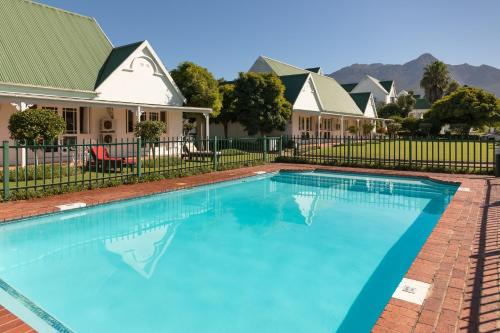 The swimming pool at or close to Protea Hotel by Marriott George King George