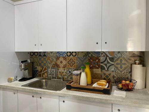 A kitchen or kitchenette at Fortel Hostel