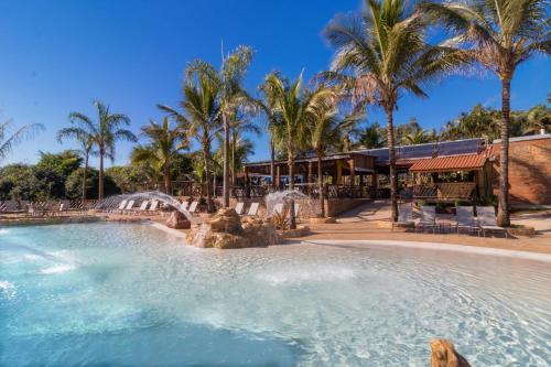 A piscina localizada em Pousada Estalagem de Brotas ou nos arredores