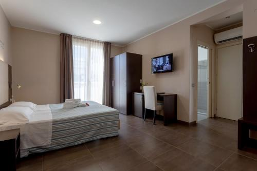 A television and/or entertainment center at Gimmi Hotel