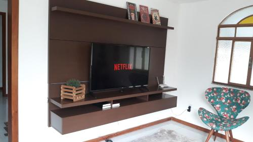 A television and/or entertainment center at Hostel Alto Caparaó